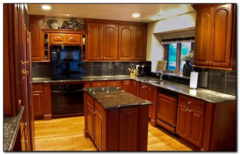 kitchen wall colors with cherry cabinets cherry kitchen cabinets with aqua blue walls in kitchen