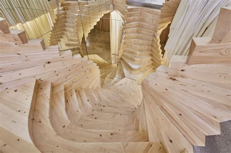 wooden staircase acme s wildly twisting wooden staircase draws inspiration