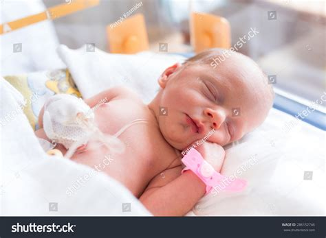 newborn baby after c section newborn baby girl in the hospital after c section stock