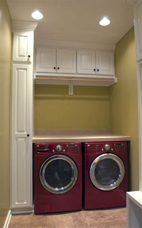 Laundry Room After Makeover Design With White Wall Mounted Cabinets In Laundry Room
