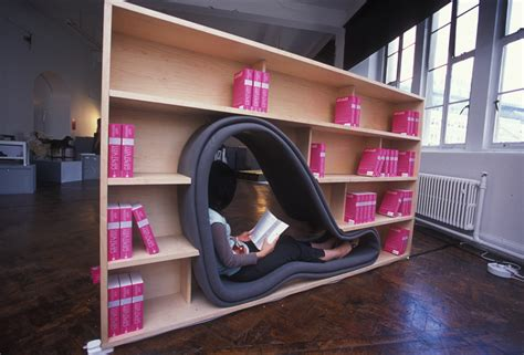 cave bookcase with reading space by adachi