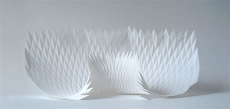 Folded Paper Sculpture - dynamic patterns form complex geometric paper sculptures