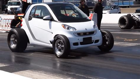 big smart car theme tuesdays big motor small car stance is everything