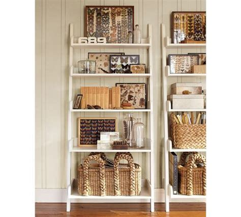 leaning wall shelf from pottery barn toy storage idea