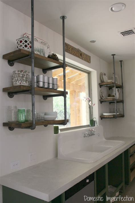 kitchen open shelves clock pendant l plates cups sink faucet industrial pipe kitchen shelving domestic imperfection