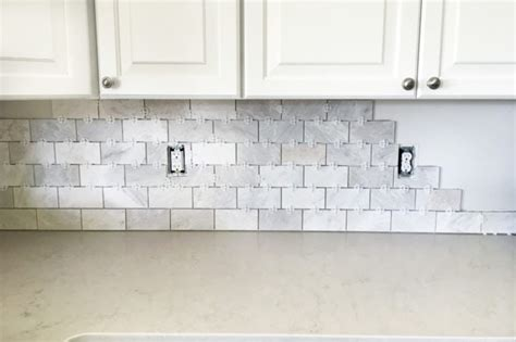 how to install subway tile backsplash kitchen how to install a marble subway tile backsplash abby lawson