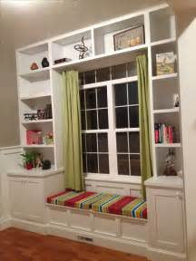 window seat and bookshelves built in bookshelves around the window with a seat for