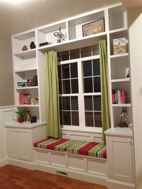built in window seat built in bookshelves around the window with a seat for
