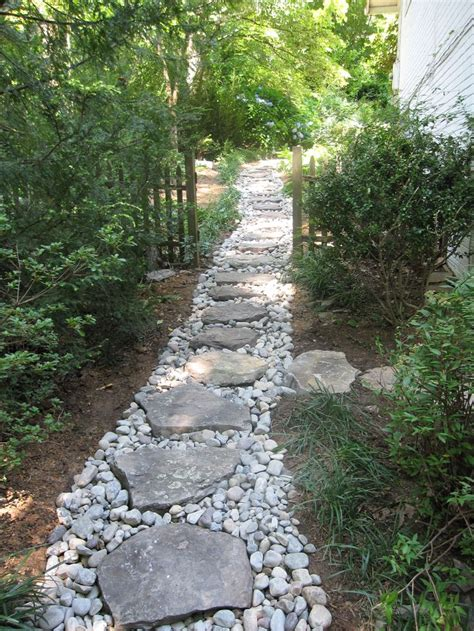 Dry Creek With Boulder Steppers Side Yard Drainage Drainage Ideas For Backyard