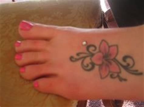 flower tattoo with dermal piercing 1000 images about piercings on pinterest dermal