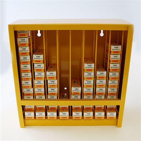 ngk dispenser holds 80 spark plugs display stand cabinet