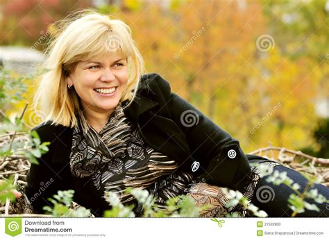 middleage woman fun middle age woman in fall time stock photo image 27532800