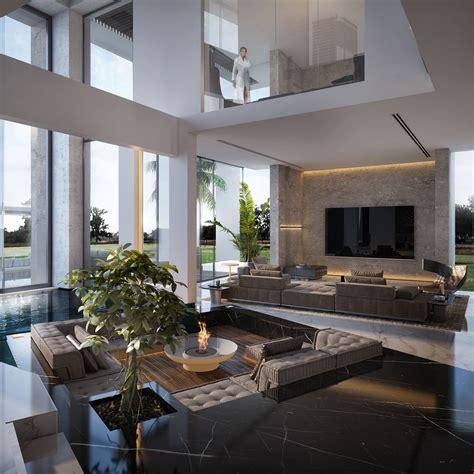 open concept sunken living room surrounded  indoor pool
