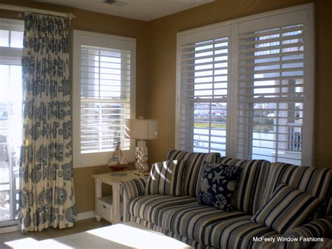 beach window treatments Family Room Tropical with Art