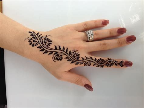 black henna tattoo on hand henna on left palm