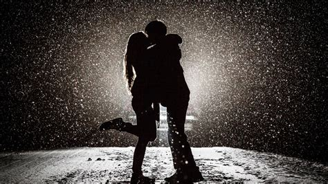 couple kissing  snow night