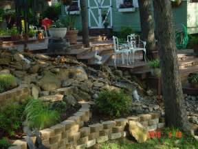 landscape ideas for sloped backyard with wooden and stone