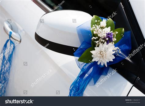 wedding car with flowers wedding car decoration with flowers and ribbons photo