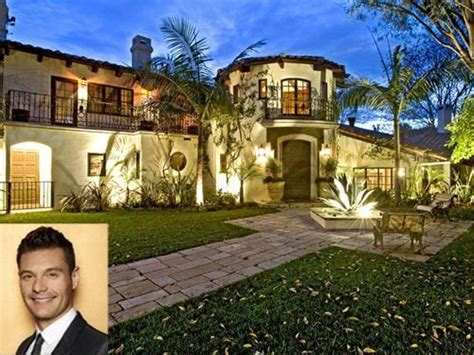 stars homes ryan seacrest re listed hollywood hills mansion for lower