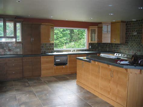 black slab kitchen cabinets brown wooden kitchen with black countertops