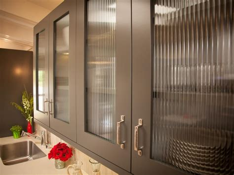 modern kitchen cabinet doors the glass doors on these gray kitchen cabinets lend a