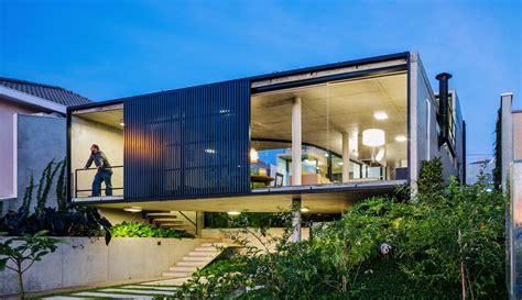 brazilian homes lush brazilian lens house treats a neighboring mountain as