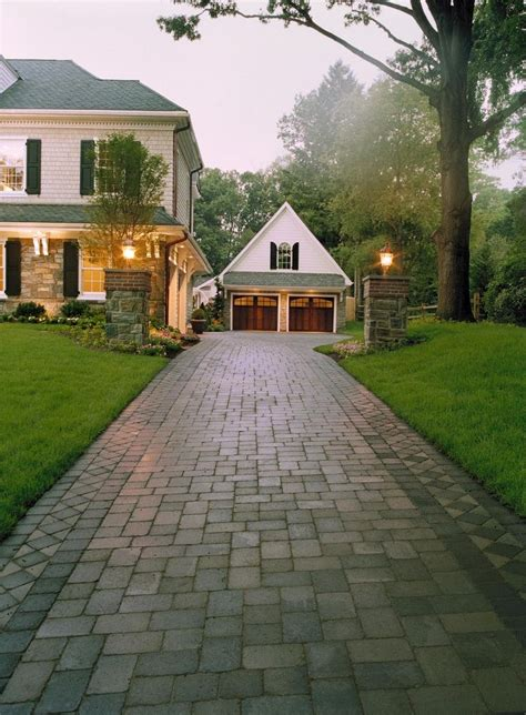block design to top of driveway note detaiing on house matches detailing on garage posts and