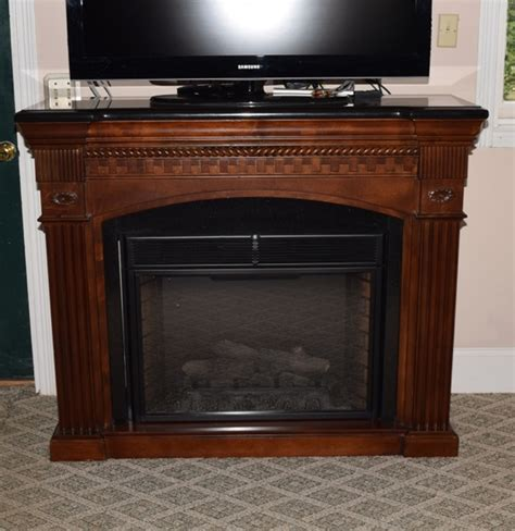 faux electric fireplace in mahogany mantel with