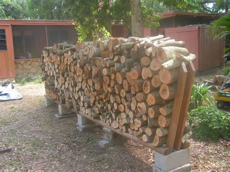 How To Make A Firewood Rack 9 easy diy outdoor firewood racks the garden glove