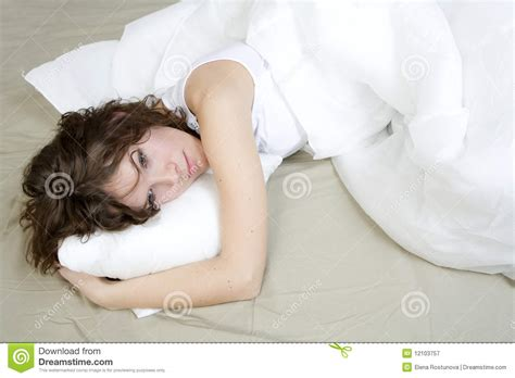 lying on the bed brunette curl woman lying on bed royalty free stock