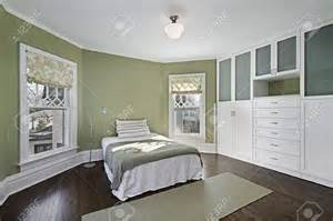 green walls bedroom master bedroom master bedroom with green walls and dark wood flooring stock photo pertaining