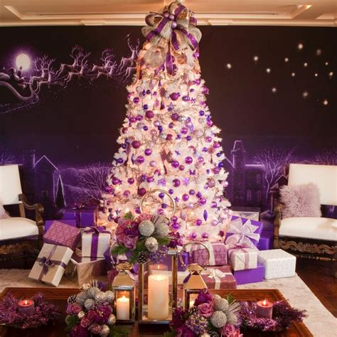 white christmas tree with purple decorations