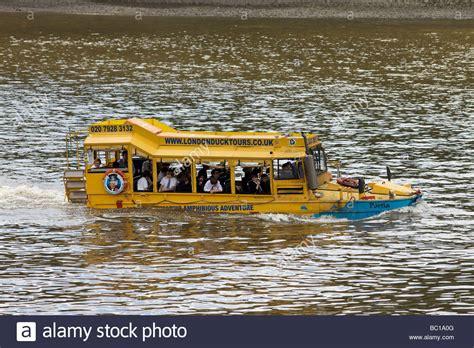 river thames yellow bus school bus uk stock photos school bus uk stock images