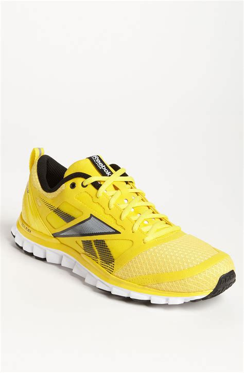 running shoes yellow reebok realflex speed running shoe in yellow for