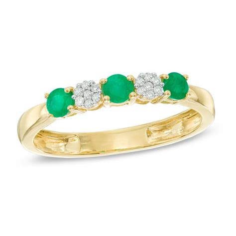 emerald and accent three ring in 10k gold