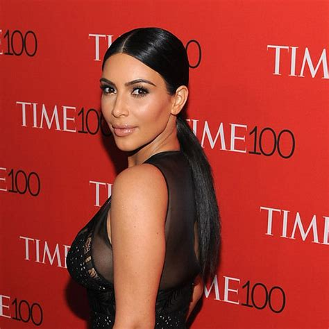 kim kardashians low sleek ponytail with center part celebrity how to create a polished ponytail for a night out padour