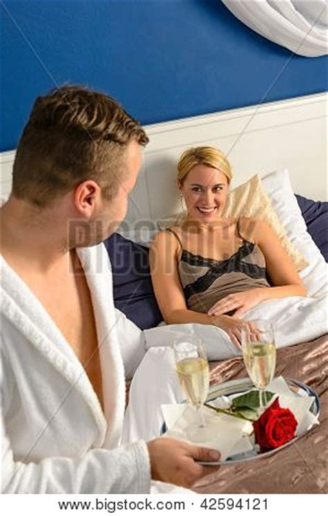 husband romance in bedroom husband flirting wife bedroom romantic evening celebration