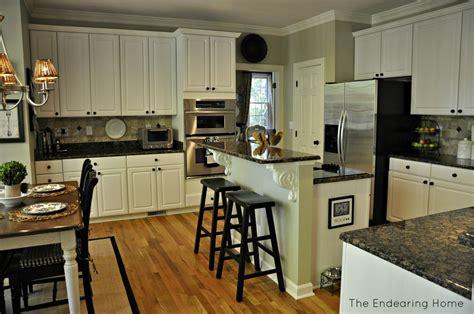 baltic brown granite white cabinets backsplash ideas