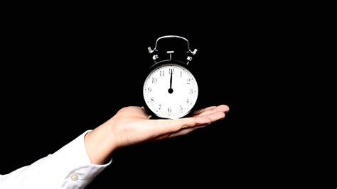 stock video  hand hold alarm clock