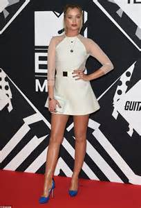 Guess Which Mtv Awards Presenter This Pair Of Stunners Belong To The Great Gam And The Gorgeous Studded Clutch by Ellie Goulding Displays Cleavage In Plunging Thigh