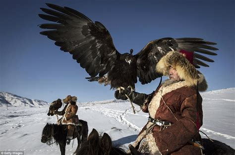 Asya Baby Yellow kazakh eagle hunters let their magnificent birds