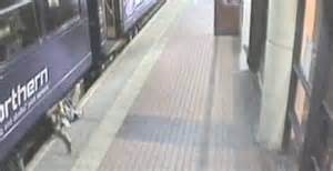 Shocking the woman is seen falling down the gap between the train and