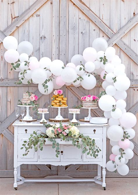 Gorgeous rustic barn wedding cake table with easy diy balloon garland rustic party ideas