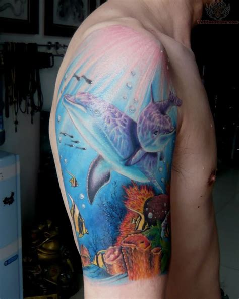 ocean sleeve tattoo blue and dolphin