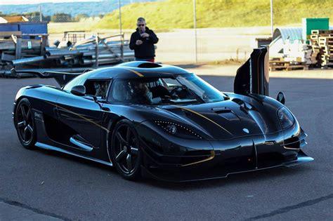 koenigsegg black black koenigsegg one 1 front side view sssupersports