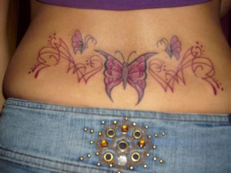 lower back coverup tattoos lower back cover up
