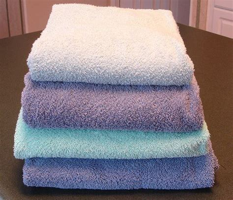how often should you wash your bathroom towels and rugs