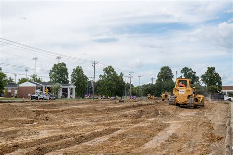 Construction Lot construction begins on temporary parking lot at