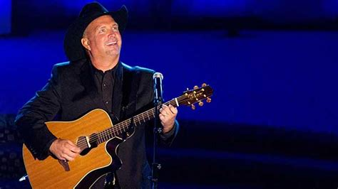 garth fan garth gives away guitar to fan with cancer at