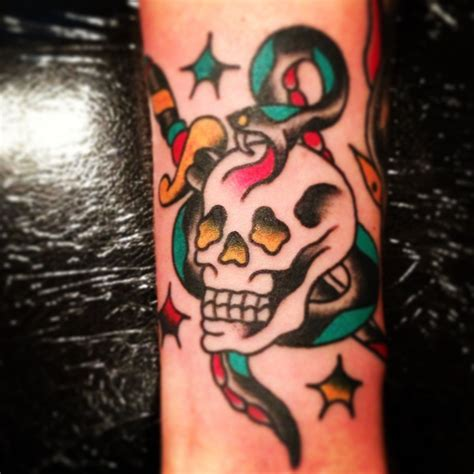 american traditional skull tattoos snake skull and dagger done by frank william at chicago